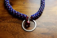 A personal favorite from my Etsy shop https://www.etsy.com/listing/101928671/avengers-inspired-necklace-captain