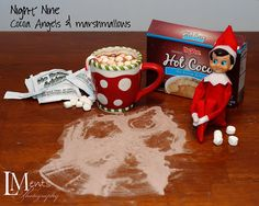 Elf leaves cocoa and marshmallows, complete with cocoa angel