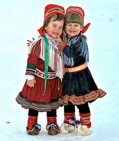 Two cute girls in their traditional costumes. Kautokeino, Norway .... Kautokeino is in the northern part of Norway called Finnmark. .... Just look at those warm-looking shoes, probably made of reindeer skin. These certainly are cute little kids, and they look very happy!