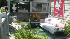 One day deck make over using nearly 100% thrift items - guess where the galvanized planter came from :)