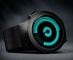Ziiiro Saturn Watch: rides through time by propelling its hour and minute through black segments.