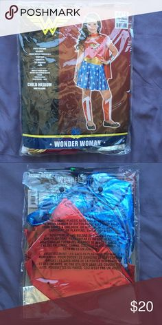 CHILD WONDER WOMAN COSTUME SIZE M Worn once. Still with original package.  Selling this for my client. (I'm also selling a majority of my closet- clothes, shoes, bags and accessories. Check out all of my other posts.) Costumes Superhero