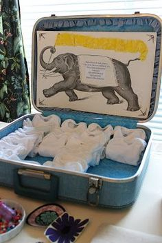 Circus baby shower Onesie station in a vintage suitcase display! via The ragged wren