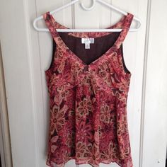 Ann Taylor Loft flowered tank top This is a dressy tank top in shades of coral, pink and brown. LOFT Tops Tank Tops