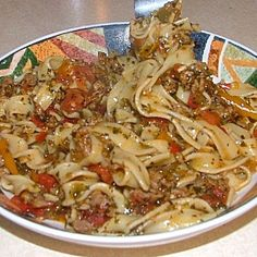 Ingredients 1 lb italian sausage 1 tsp salt 1 tsp italian seasoning tsp black pepper 1 red pepper, diced 1 yellow pepper, diced 1 orange pepper, diced 4 clove garlic, pressed c white wine (like chardonnay) 1 can(s) diced tomatoes with juice Pasta Recipes, Beef Recipes, Dinner Recipes, Cooking Recipes, Egg Noodle Recipes, Recipies, Italian Dishes, Italian Recipes, Al Dente