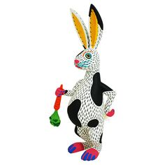 Fantastic rabbit with its carrot by top Oaxacan artist Luis Pablo. Luis Pablo is considered one of the top wood carving artists in Oaxaca and one of the few Oaxacan carvers that makes everything himself… he designs, carves and paints his pieces.  A great piece!