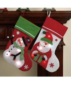 Hang these LED light-up stockings by the chimney with care and light the way for Santa when he arrives.