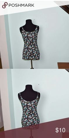 Adorable Floral Print Tank Top In excellent condition. Super soft and comfortable. Buy 3 items, get one free plus 15% off your purchase total! Tops Blouses