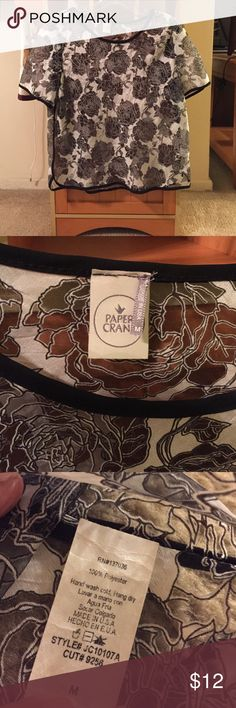"Paper Crane sheer floral blouse Sz M Beautiful black & white sheer floral blouse from Paper Crane.   Size M - will fit on the small side. Pit to pit = 18"" Shoulder to hem = 22""  Black pipping on sleeves, neckline, sides & hem. Will need an under garment.   New without tags.   Price firm unless bundled ❤️ Paper Crane Tops Blouses"