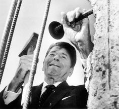 Ronald Reagan hammering on one of the last remnants of the Berlin Wall