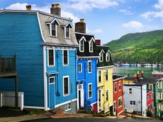 BEAUTIFUL SCENE - ST JOHN'S, NEWFOUNDLAND, CANADA North America's oldest city, the seaside town is famous for Jellybean Row, which features a cluster of colourful historic houses. There are various stories behind the bright paint job with some claiming th Newfoundland Canada, Newfoundland And Labrador, Newfoundland St Johns, Ontario, Cabot Trail, Ottawa, Barbados, Jamaica, Trinidad