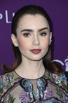 Lily Collins Keeps it Showy for the Costume Designers Guild Awards   Tom + Lorenzo