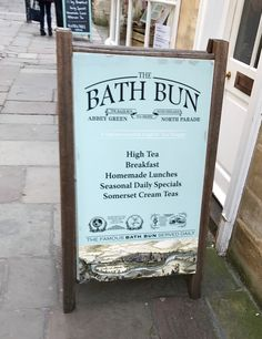 Bespoke wooden pavement sign grabbing peoples attention outside a Tea house in Bath