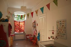 Great idea to string a pennant banner across a room!  Hmm, to place it above the crib flush with the wall or across the room...