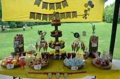 Pinocchio themed dessert table.  Desserts included: cake, cupcakes, cake pops, popcorn, cotton candy, crepes, cookies, candy apples, jello and candy bar.  Banners, cupcake wrappers, popcorn boxes, cotton candy cones, birthday hat, tags and all pinocchio characters have been cut by our die cutting machine - www.dolcerellabakery.ca