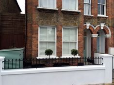victorian front garden company walls rails black and white mosaic tile path bespoke bin store olive tree topiary plants balham clapham battersea london (2)