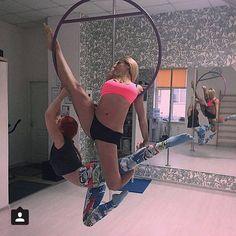 @mazurenkojulia and her friend twist into this fun looking Lyra partners trick.