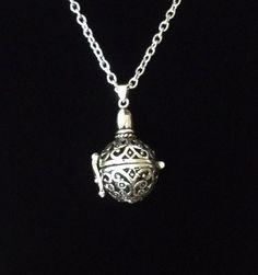 A personal favorite from my Etsy shop https://www.etsy.com/listing/193979032/silver-hollow-ornate-prayer-ball-opening
