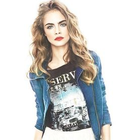 Cara Delevingne makeup look: Bold brows and red lips.