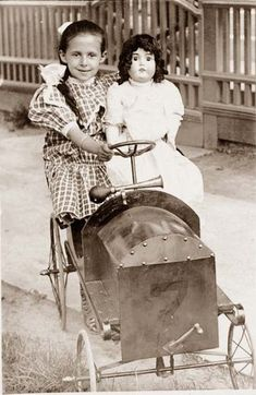 MISSY BIGGY: Antique photo of girl in pedal care with her large doll circa 1910.