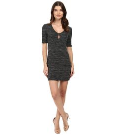 This Ava Keyhole Mini Dress will be everything you need this season. ; Fitted silhouette on a blended fabrication. ; Keyhole cutout at V-neckline. ; Short sleeves. ; Slip-on design. ; Straight hemline. ; 83% rayon, 7% polyester, 6% cotton, 4% spandex. ; Hand wash cold, dry flat. ; Made in the U.S.A. and Imported. Measurements: ; Length: 32 in ; Product measurements were taken using size SM. Please note that measurements may vary by size.