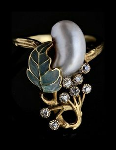 Georges Fouquet   An exceptional Art Nouveau ring in the manner of Georges Fouquet. The foliate design with plique-à-jour enamel & diamonds with a baroque-shaped natural pearl.