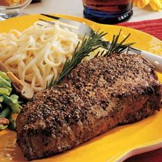 Peppercorn Steaks Ingredients: 1 tablespoon whole black peppercorns, crushed 2 boneless beef top loin steaks (8 ounces each) 2 to 3 tablespoons butter, melted 1 to 2 garlic cloves, minced 1 tablespoon...