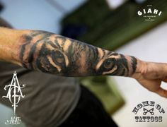 Arm Tiger Eyes tattoo by Agat Artemji