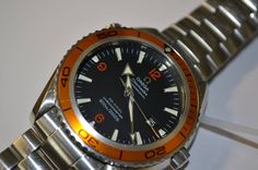 Men's Omega Seamaster Coaxial with delightful orange bezel. Full service carried out on the movement.