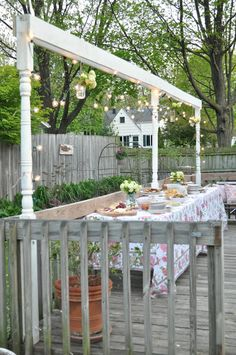 Back yard outdoor party set up on a deck...I love the raised level for hanging items ....can do!