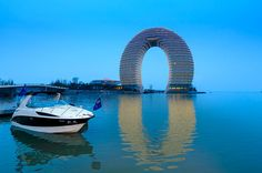(Credit: Sheraton Huzhou Hot Spring Resort) Weird and wonderful hotels around the world:  1. Sheraton Huzhou Hot Spring Resort, Huzhou, China (If you're looking for somewhere unusual to stay while in China, what could be better than a hotel that is literally set on the water. The Sheraton Huzhou boasts a unique half ring shape with stunning views over Lake Taihu. Huzhou is one of China's four major silk-producing cities.