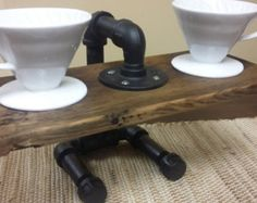 Double pour over coffee stand. Made with pipe and reclaimed barnwood. Coffee drippers not included, must be purchased separately from other sellers. Pour Over Coffee Maker, Coffee Business, Coffee Stands, Cooking Equipment, Industrial Pipe, Pipe Furniture, Reclaimed Barn Wood, Coffee Cafe, Cover