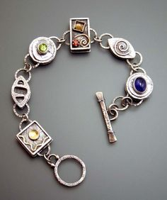 Custom Sterling Silver Bracelet by relics of a new age (Una Barrett)