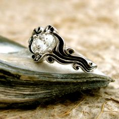 0.82 ct Oval White Sapphire Ocean Sea Surf Engagement Ring in 14K White Gold with Black Waves. $1,460.00, via Etsy.