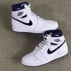 This is the Air Jordan 1 Retro High OG Metallic Navy hub. All images and  updated info on the shoe can be found here.