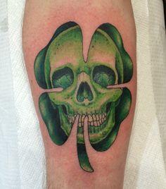 Death shamrock tattoo.
