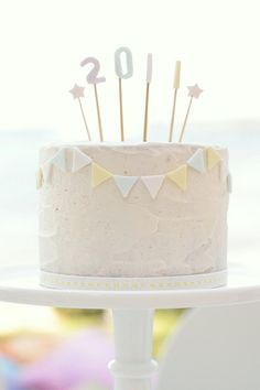 nye cake! by hello naomi, via Flickr. Bunting around the outside. Candles and sparkles in the middle. Use glitter shapes?