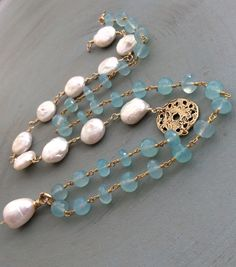 Hey, I found this really awesome Etsy listing at https://www.etsy.com/listing/280782036/coin-pearl-and-chalcedony-necklace