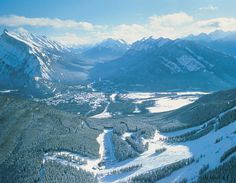 Banff, Alberta, Canada.  Banff's landscape will leave you in awe. Truly a different world in Banff, carved out by mother nature centuries ago.  If you're ok with colder temps, but great snow and amenities, Banff is a must see.