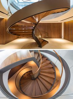 This large sculptural spiral staircase that rises up from the basement to the main floor of the home has wood treads and glass safety railings that let light pass through them to keep the spaces feeling bright.