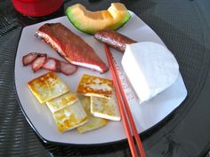 Chinese Food: Found treasures (cured pork tenderloin, sausage, goat cheese, fresh and pan fried, and hami melon from my local wet market, Kunming, Yunnan, China