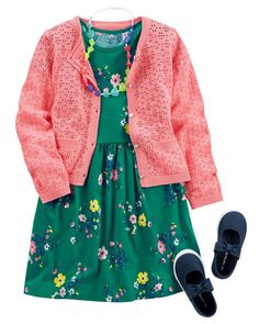 She's picnic ready in a breezy dress and easy-on sneakers. A classic cardi and fun necklace finish the look sweetly.