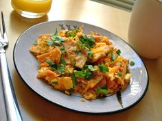 Quick Migas is a short cut version of the southwest classic that combines eggs, tortilla chips, salsa, and cheese for a hearty breakfast.