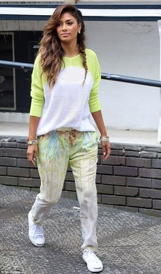 Colourful: The Hawaiian beauty wore a two-tone sweater and patterned trousers as she visit...