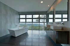 The Grand Designs Australia Ocean View house is considered by its owners as a building with two personalities. Find out why. Exterior Design, Interior And Exterior, Grand Designs Australia, Latest House Designs, Laundry In Bathroom, Unique Furniture, New Homes, Bathroom Ideas, Modern Bathrooms