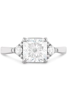 """Engagement Rings - What Your Engagement Ring Says About  A Flair for the Dramatic Your ring has: A large square diamond You are: Confident and proud. """"Your ring no doubt says, 'I got a rock,'"""" Sabatino says. That big, gorgeous statement piece is a reflection of your glam, Old Hollywood style. You love making an entrance and enjoy being the life of the party."""