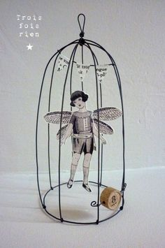 """On fait le plein de poésie chez """"Trois fois rien"""" i am thankful to Flanigan Flanigan-Denise Anderson for getting me passed my wire phobia. look at the possibilities! Wire Crafts, Paper Crafts, Paper Dolls, Art Dolls, Art Altéré, Art Fil, Paperclay, Bird Cages, Assemblage Art"""