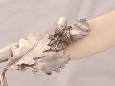 Detail of Austrian oak leaf & acorn silver & ivory 1890 paper knife. Acorns Grow, Acorn And Oak, Mighty Oaks, Little Acorns, Antique Desk, Oak Leaves, Metalworking, Squirrels, Pine Cones