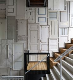 Wall panelling made from reclaimed doors. De Borneohof, Amsterdam | Peter Geusebroek.