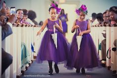 Purple flower girl dresses and headpieces